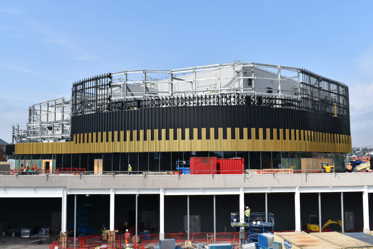 Installation of Arena gold panels